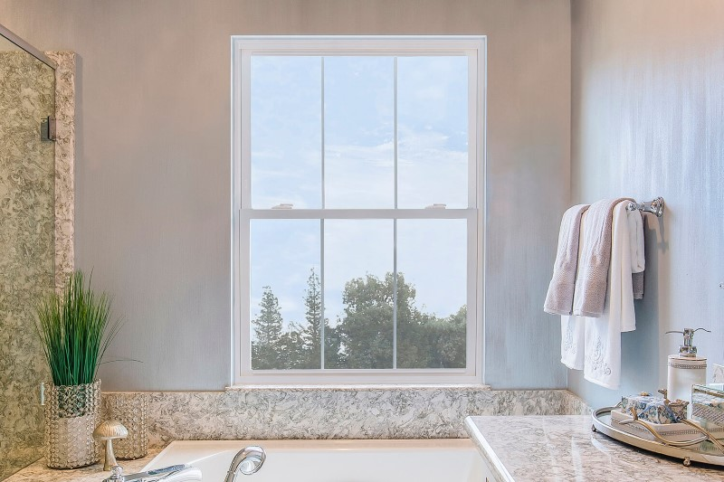 Anlin double hung window in a bathroom